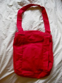 red messenger bag back