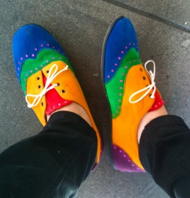 rainbows on the soles of her shoes